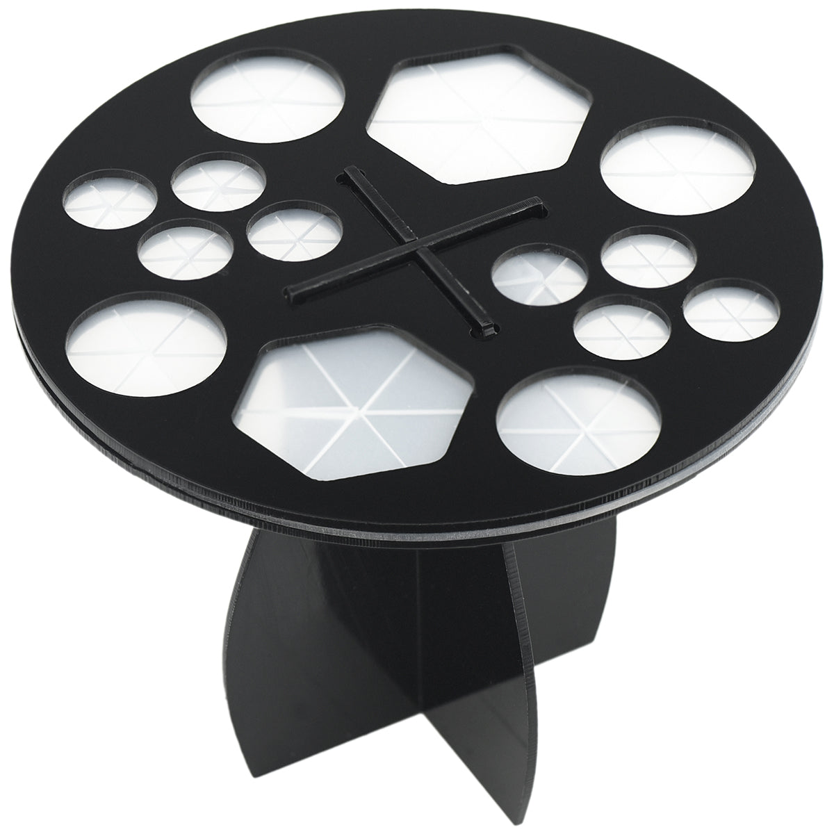 A black acrylic round shape makeup brushes drying rack with 14 silicone holes. Two holes are in hexagon shape, the rest of holes are round.
