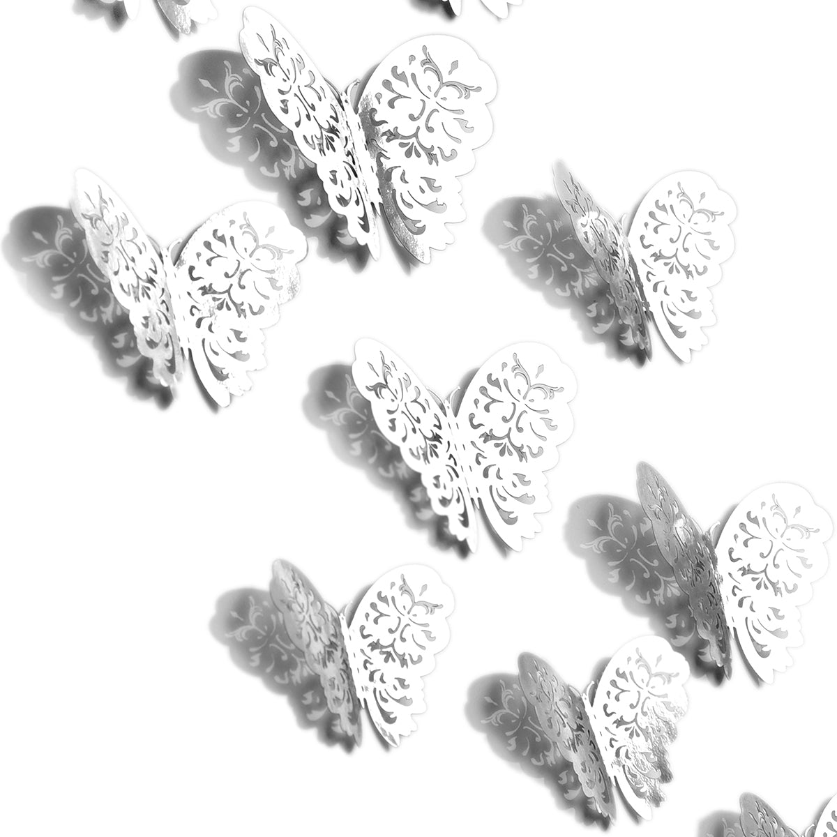 Couples of silver metallic butterflies with white background.