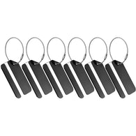 Six black luggage tags placed upright