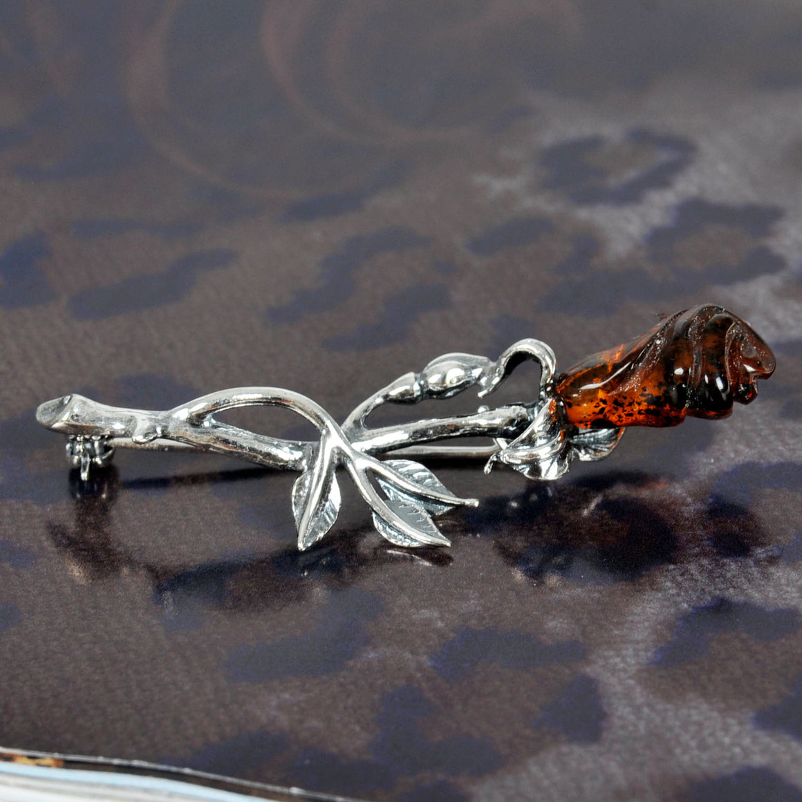 Amber dark rose brooch