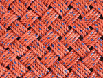 Handwoven Maine made orange entry mat made from upcycled lobster rope
