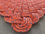 Handmade upcycled orange lobster rope door mat made in Maine