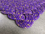 Purple door mat with yellow flecks made with repurposed lobster rope