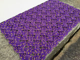 Vibrant purple doormat handwoven in Maine