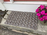 Maine charcoal welcome mat with coral flecks made with upcycled lobster rope
