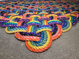 Oversized rainbow-like variegated patio rug made from upcycled lobster rope