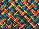 Handwoven vivid upcycled lobster rope runner in rainbow pattern