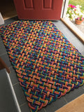 Oversized entryway mat made from multicolored reclaimed lobster rope