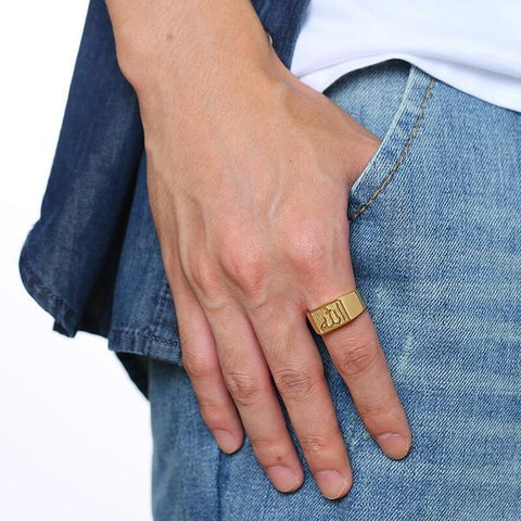 New Allah Stainless Steel Signet Ring In Gold Tone on Model hand from Almas Collections