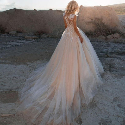 Sleeveless Tulle Boho Bridal Gown Wedding Dress from Almas Collections