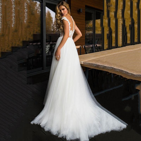 back view of Long Princes Beach Wedding Dress from Almas Collections