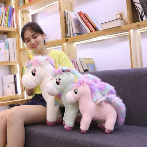 Image of Glowing Winged Unicorn Plush Toy in 3 different colors Pink, Blue and white from Almas Collections