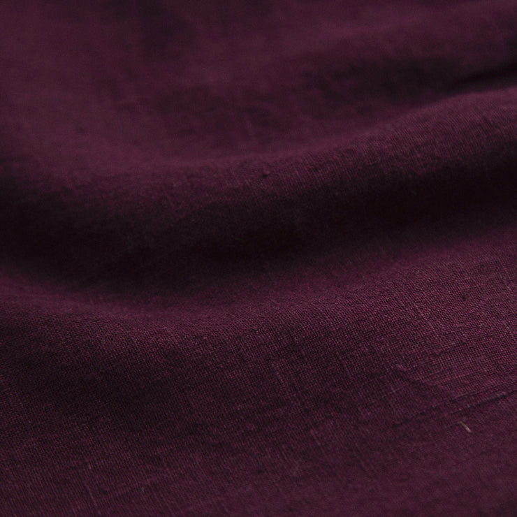 Gathered flared skirt with attached adjustable braces, that tie through loops at the back for an adjustable, comfortable fit. Made from beautifully soft deep Aubergine linen. Designed to sit above the knee. Elasticated waist creates a full look whilst being comfortable and easy wearing.