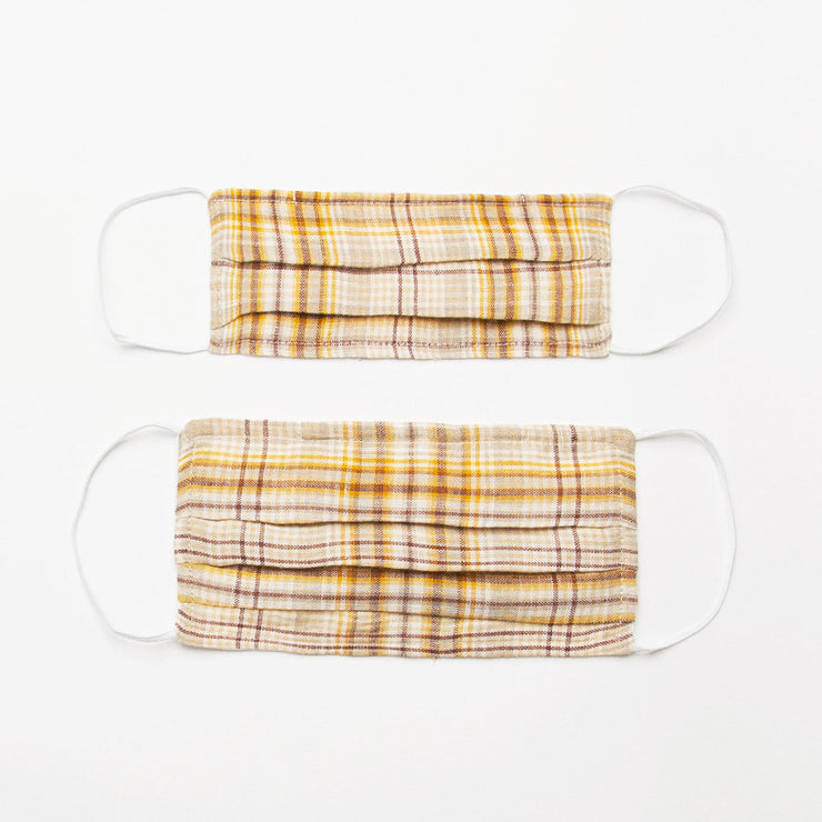 Reusable, triple layer, linen face mask, with soft rounded elastic ear loops, pleated shape and soft wire to shape to the nose. Made from buttermilk plaid linen outer, a single layer of plain cotton in the middle and milk white linen on the inside to sit against face (this linen will either be plain or the polka dot from the collection - the polka dot is not a noticeable texture and still comfortable on the skin).