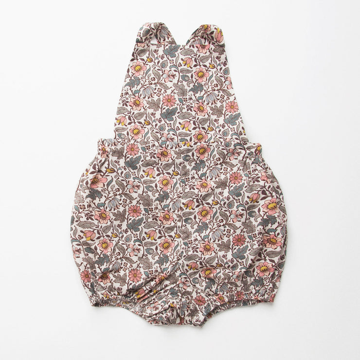 All in one romper, with bib front, elasticated waist and full bloomers with elasticated leg holes and poppers. Straps tie through loops at the back so fully adjustable (18-24M / 3-4Y). Smaller sizes fasten through a single button on the back, with buttonholes to adjust strap length (3-6M /6-12M /12-18M). Designed to sit at the top of the thigh, perfect paired with tights in winter and without in the summer. Made from Emery Walker Liberty print tana lawn cotton.