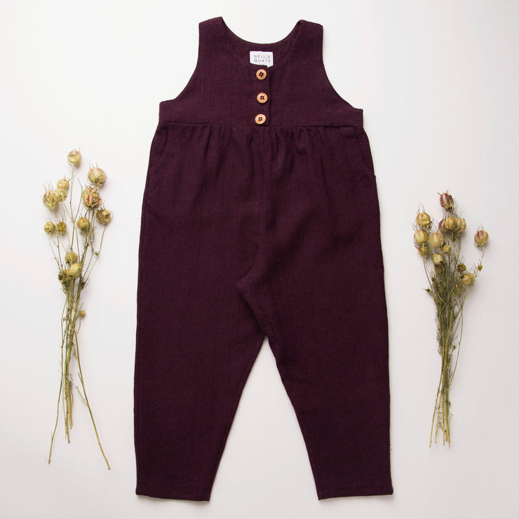 Comfy jumpsuit with button up front, gathered empire line and front pockets for storing treasure. Loose fitting trousers can be styled with a rolled up hem and turned down for growth spurts. Perfect layered over a Mother May I Blouse, or stripped back in the summer. Made from beautifully soft, deep aubergine linen.