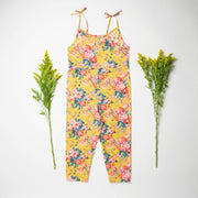 Comfy jumpsuit with loosely fitted wrap over top and tie up shoulder straps. Loose fitting straight leg trousers can be styled with a rolled up hem, turned down for growth spurts. Made from beautifully soft, Magical Bouquet Liberty print linen.