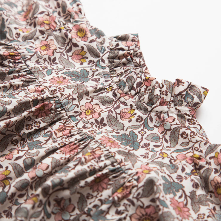 Full, floaty dress, with high empire line, full elasticated sleeves, small neck ruffle and mother of pearl buttons down the back yolk. Attached gathered skirt sits at a longer length below the knee. Designed to be oversized for a stylish, comfortable fit. Made from Emery Walker Liberty print tana lawn cotton.