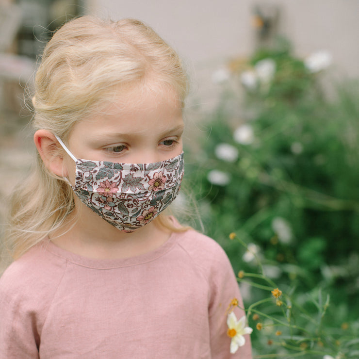 Reusable, triple layer, cotton face mask, with soft rounded elastic ear loops, pleated shape and soft wire to shape to the nose. Made from Emery Walker Liberty print outer, with two additional layers of plain cotton.  Please note these are not medical grade face masks and should be washed on high temperatures regularly after use. Please ensure you still follow government guidelines on social distancing even when wearing this face mask.