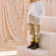 Easy wear straight leg trousers, with elasticated waist and front pockets. Designed to fit loosely and sit on or below the waist. Made from super soft buttermilk plaid linen.