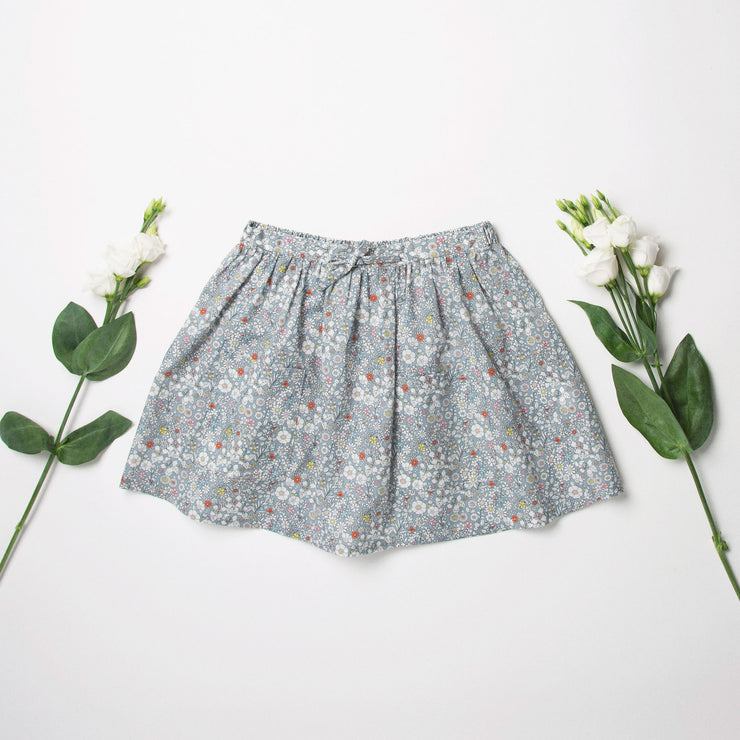 Gathered flared skirt, made from beautifully soft June's Meadow Liberty print tana lawn. Designed to sit above the knee. Elasticated waist with drawstring tie creates a full look whilst being comfortable and easy wearing.