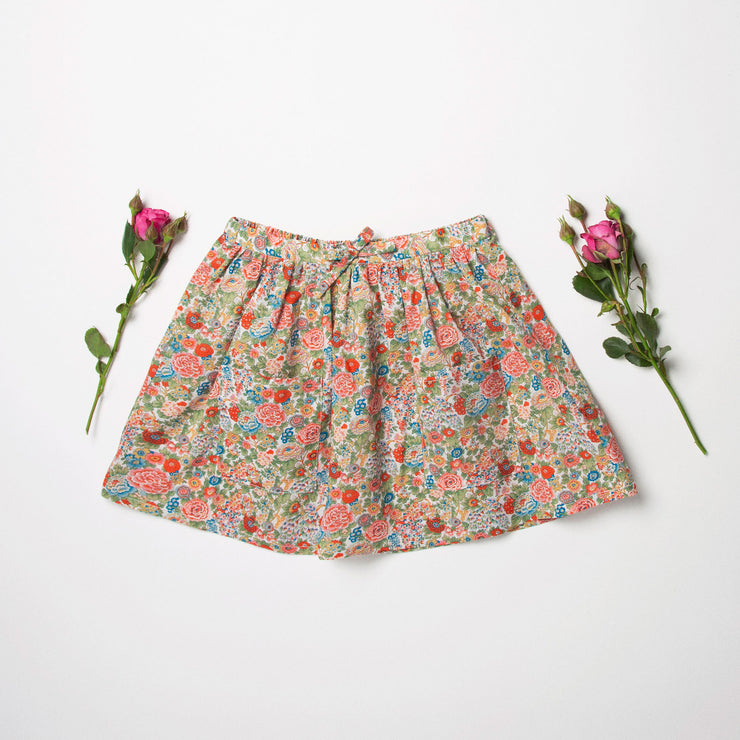 Gathered flared skirt, made from beautifully soft Elysian Day Liberty print tana lawn. Designed to sit above the knee. Elasticated waist with drawstring tie creates a full look whilst being comfortable and easy wearing.