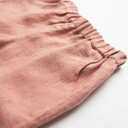 Easy wear straight leg trousers, with elasticated waist and front pockets. Designed to fit loosely and sit on or below the waist. Made from super soft dusty rose linen.