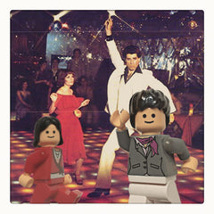 Curio & Co. watches Saturday Night Fever with Jasper Fforde. Background image of John Travolta & Karen Lynn Gorney dancing in Saturday Nigh Fever with Lego posing the some way in foreground. Curio and Co. www.curioandco.com