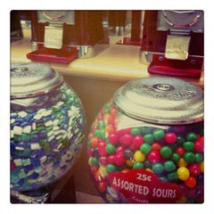 Curio & Co. enjoys candy from old-time vending machines. Photo of gum ball vending machines. Curio and Co. www.curioandco.com
