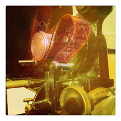 Curio & Co. looks at the dying art of film. Photo of old fashioned movie projector. Curio and Co. www.curioandco.com