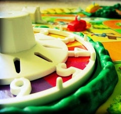 Curio & Co. plays classic board game Life