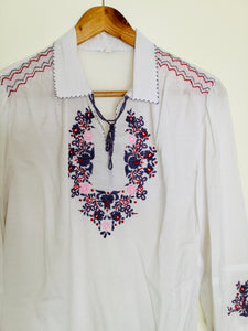 Vintage white peasant style top with floral embroidery