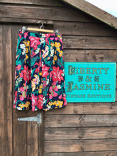 Load image into Gallery viewer, Navy midi skirt with vibrantly coloured floral print