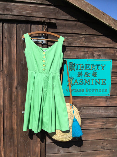 Sleeveless green fit and flare summer dress