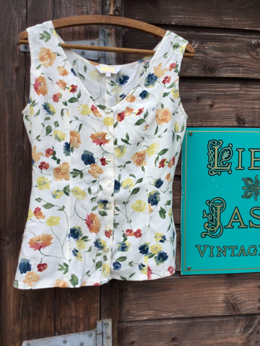 Sleeveless floral button front top