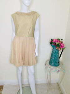 Vintage cocktail dress with gold bodice and blush pleated skirt