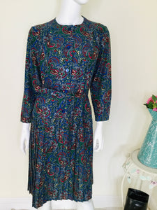 Blue vintage paisley print dress with button front and pleated skirt