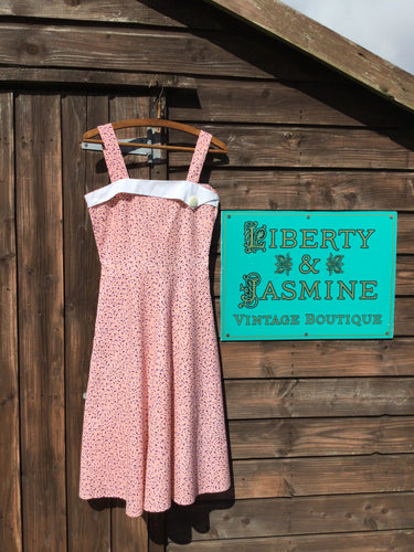 Pink strappy fit and flare summer dress