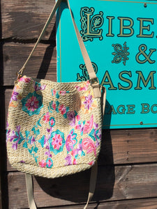 Boho style straw bag with floral embroidery