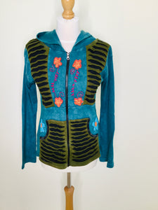 Teal hooded jacket with zip front, pockets and floral appliqué