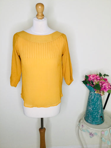 Mustard silk top with scoop neck and 3/4 sleeves
