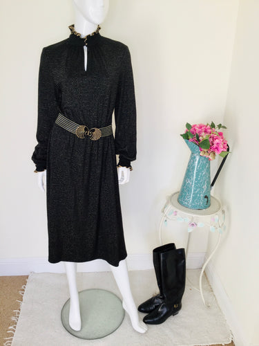 vintage black and gold long sleeved dress with ruffle collar
