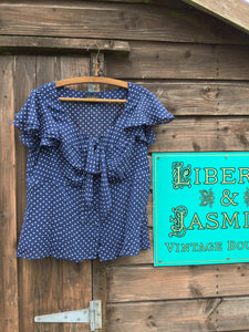 Navy polka dot blouse with pretty flutter sleeves