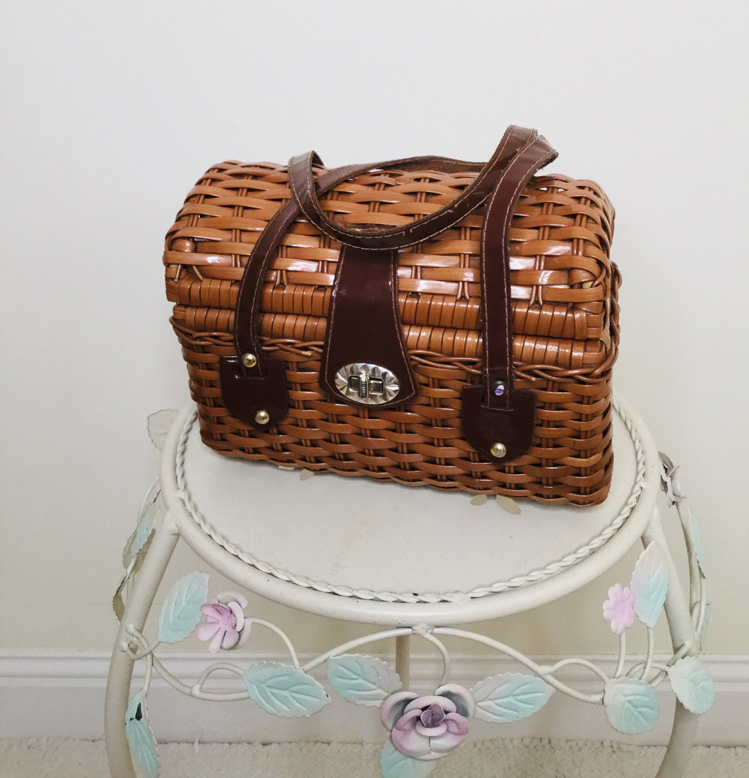 Vintage tan wicker bag with brown patent leather handles