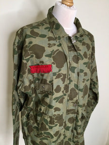 Reworked camouflage jacket with red fringing on the breast pocket