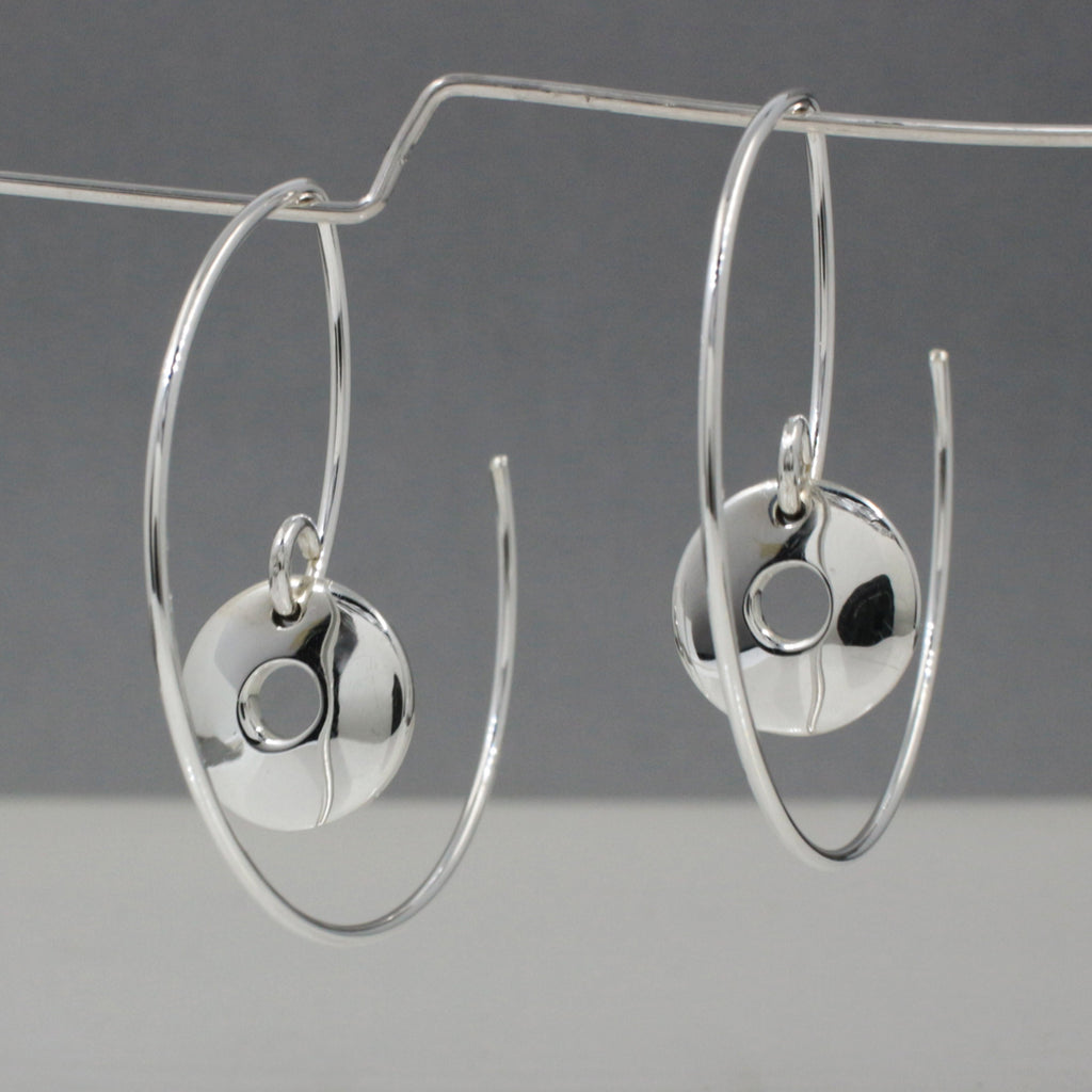 "Hoop's Diameter ~ 35 Millimeters (1.3/8"" Diameter) 20 Gauge Tempered Sterling Silver Wire Inner Off-Center Disc ~ 10 Millimeters In Diameter. (3/8"" Diameter) .950 High Polished Sterling Silver Finish How To Wear These Earrings? Just Insert The Earring From The Back Of Your Earlobe And Work Forward Until The Small Off-Center Disc Earrings Face Forward. These Dimensional Silver Hoop Earrings Look Great From Any Angle."