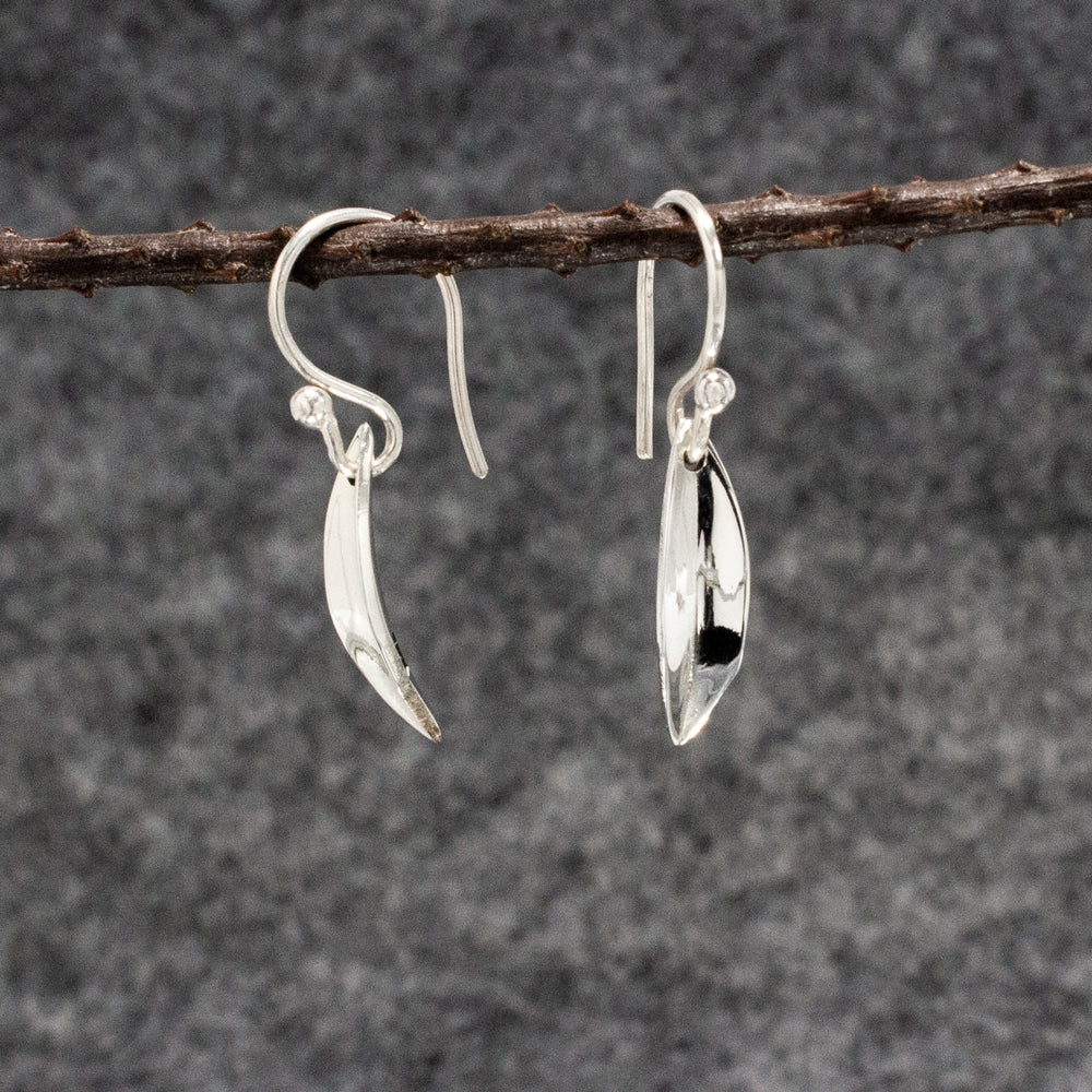 Sterling Silver Dangle, French Wire Earrings Earrings Small Pod With High Polished Finish. Find silver jewelry near me, silver earrings, silver Dangle, French Wire Earrings earrings, silver hoop earrings, silver pendant, silver bracelet, silver ring, silver jewelry wholesale, wholesale silver, wholesale jewelry.