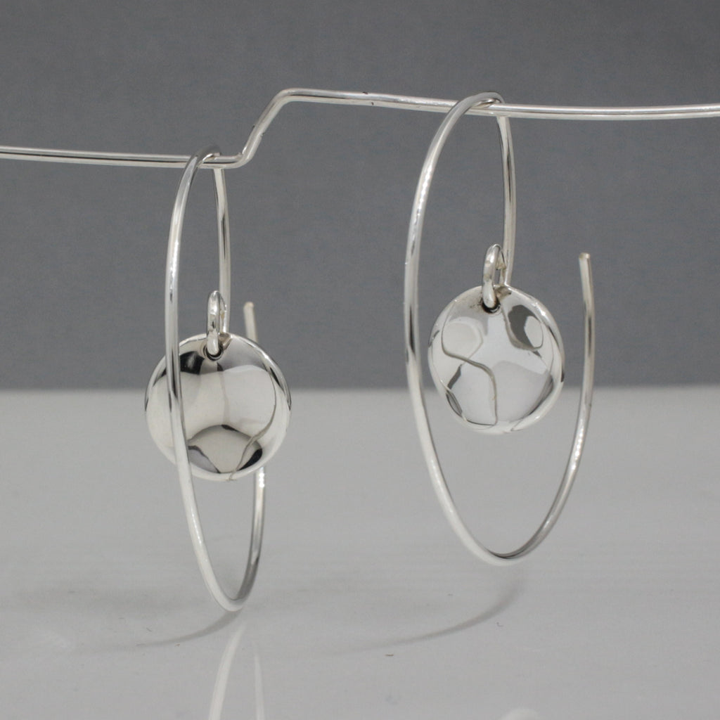 "Hoop's Diameter ~ 35 Millimeters (1.3/8"" Diameter) 20 Gauge Tempered Sterling Silver Wire Inner Small Selene Disc Earrings ~ 10 Millimeters In Diameter. (3/8"" Diameter) .950 High Polished Sterling Silver Finish How To Wear These Earrings? Just Insert The Earring From The Back Of Your Earlobe And Work Forward Until The Small Selene Disc Earrings Face Forward. These Dimensional Silver Hoop Earrings Look Great From Any Angle."