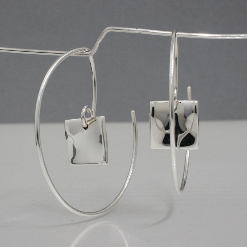"Selene Square Within Hoop Sterling Silver Earrings (Reverse Silver Earrings. Hoop's Diameter ~ 35 Millimeters (1.3/8"" Diameter) 20 Gauge Tempered Sterling Silver Wire Inner Selene Square ~ 10 Millimeters Long X 10 Millimeters Wide (3/8"" Long By 3/8"" Wide) .950 High Polished Sterling Silver Finish How To Wear These Earrings? Just Insert The Earring From The Back Of Your Earlobe And Work Forward Until The Selene Square Earrings Face Forward. These Dimensional Silver Hoop Earrings Look Great From Any Angle."