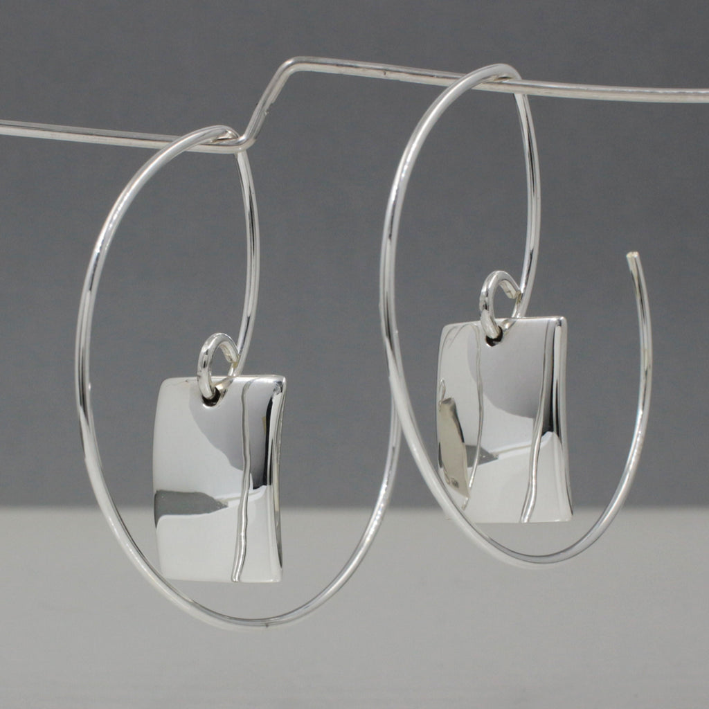 "Hoop's Diameter ~ 35 Millimeters (1.3/8"" Diameter) 20 Gauge Tempered Sterling Silver Wire  Inner Rectangle Earrings ~ 14 Millimeters Long By 10 Millimeters Wide. (9/16"" Long By 3/8"" Wide) .950 High Polished Sterling Silver Finish How To Wear These Earrings? Just Insert The Earring From The Back Of Your Earlobe And Work Forward Until The Rectangle Earrings Face Forward. These Dimensional Silver Hoop Earrings Look Great From Any Angle."